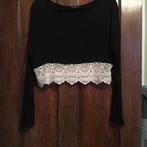 Black long sleeve crop top with cream lace bottom